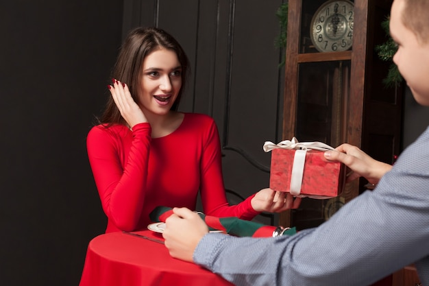 Attractive gift to a beautiful woman in luxury restaurant.