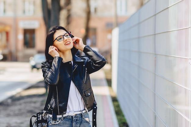 Attractive girl funny listening music in headphones
