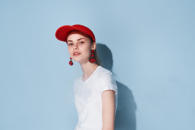 Attractive girl in red cap summer clothes fashion posing