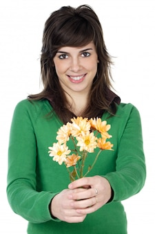 Attractive girl with flowers a over white background