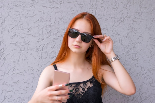 Attractive girl with smartphone
