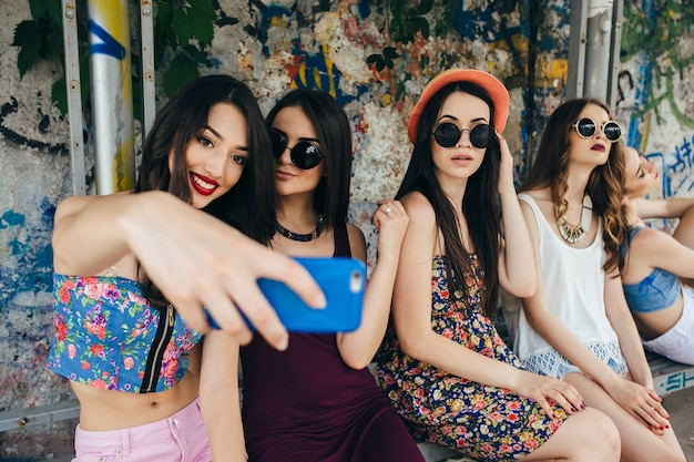 Attractive girls taking a photo