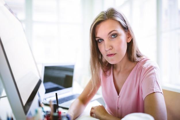 Attractive graphic designer at desk