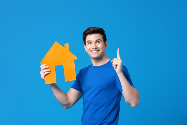 Attractive handsome american man holding a housing model