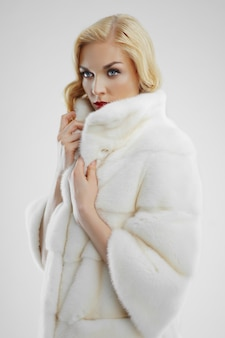 Attractive lady in white fur coat