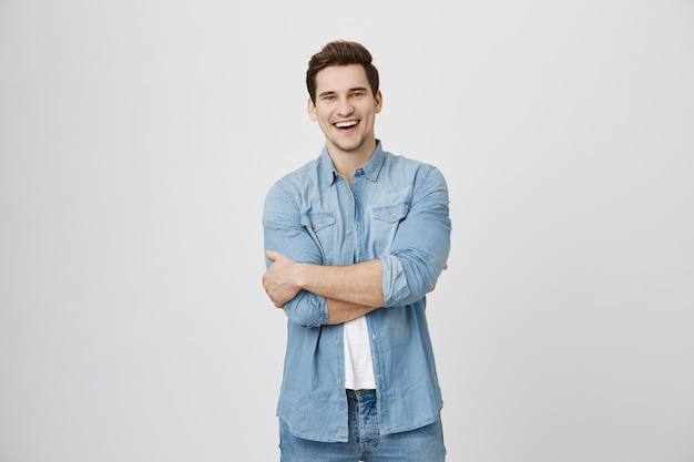 Attractive laughing guy having fun, smiling happy