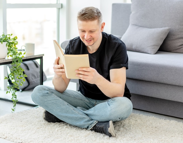 Attractive man reading paper book
