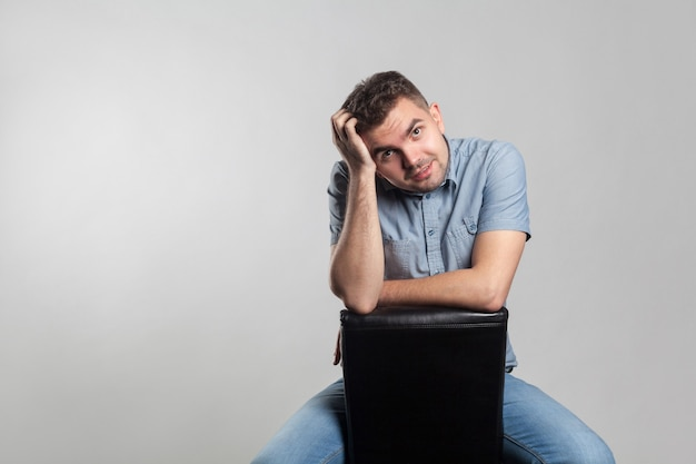 Attractive man sit touching head and thinking