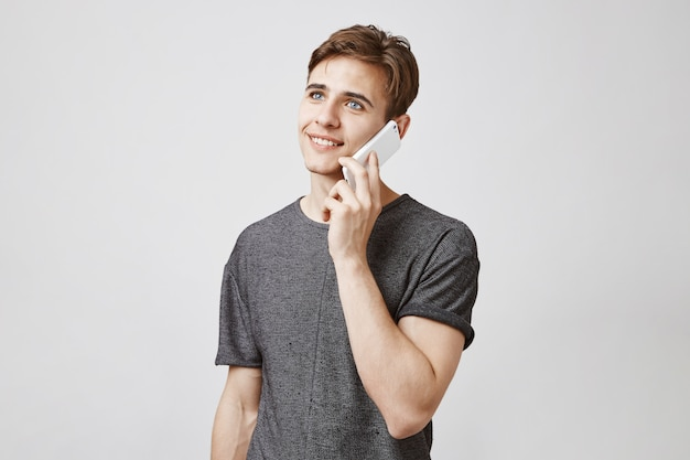 Attractive man talking on the phone
