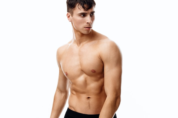 Attractive man with an athletic physique and cubes on his stomach
