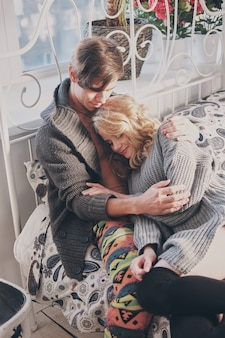 Attractive man and woman in the bedroom together cuddling cute