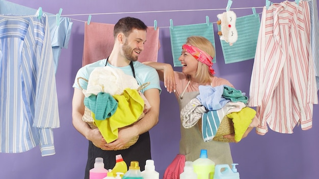Attractive man and woman having a break while performing household duties. the woman put her hand on the man's shoulder