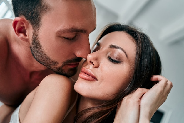 The attractive man and woman kissing