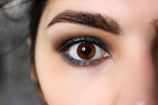 Attractive millennial female right dark brown eye