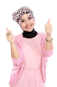 Attractive muslim woman giving thumbs up