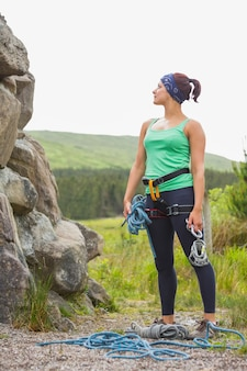 Attractive rock climber looking up at her challenge