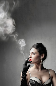 Attractive sexy woman smoking