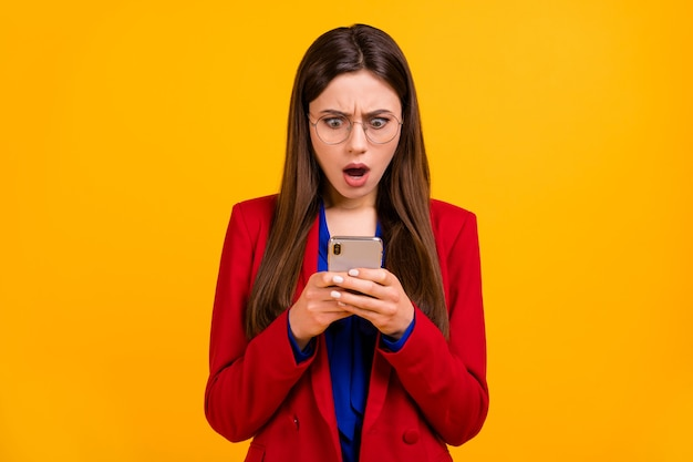 Attractive shocked business lady open mouth read telephone bad news