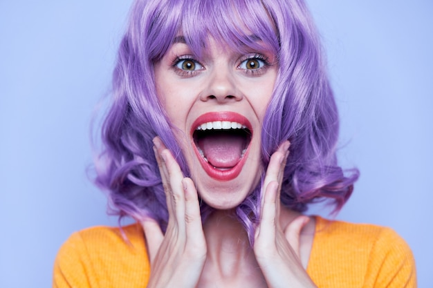 Attractive smiling woman with purple wig