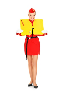 An attractive stewardess presenting a life vest over white background