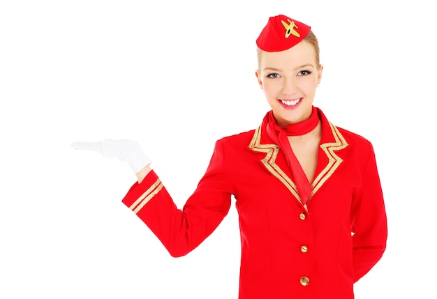 An attractive stewardess presenting your product over white background