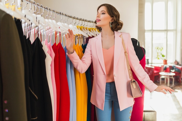 Attractive stylish woman choosing apparel in clothing store
