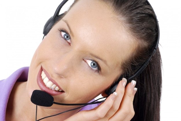 Attractive telephone worker listening attentively to a customer