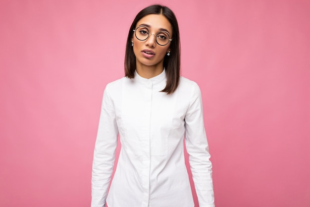 Attractive upset young brunette woman wearing everyday stylish clothes