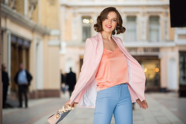 Attractive woman dressed in trendy outfit walking in street of milan on shopping