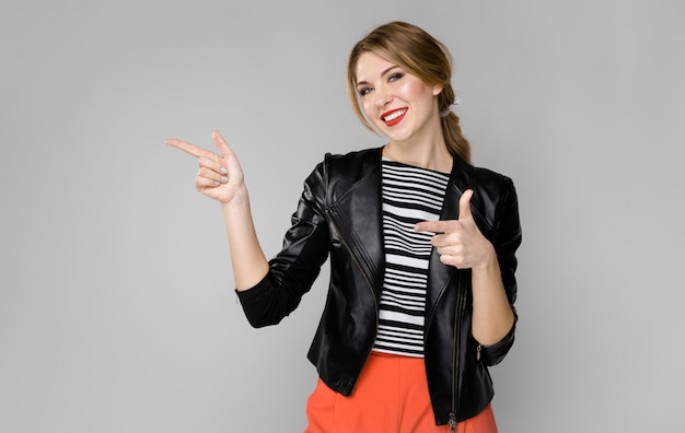 Attractive woman in fashionable clothes