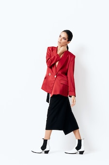 Attractive woman in fashionable galamart suit posing