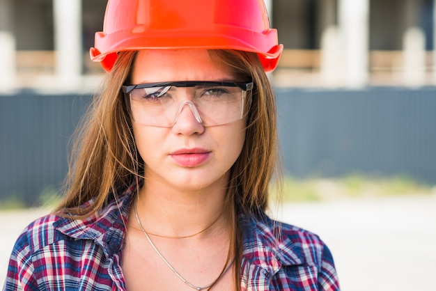 Attractive woman in hardhat