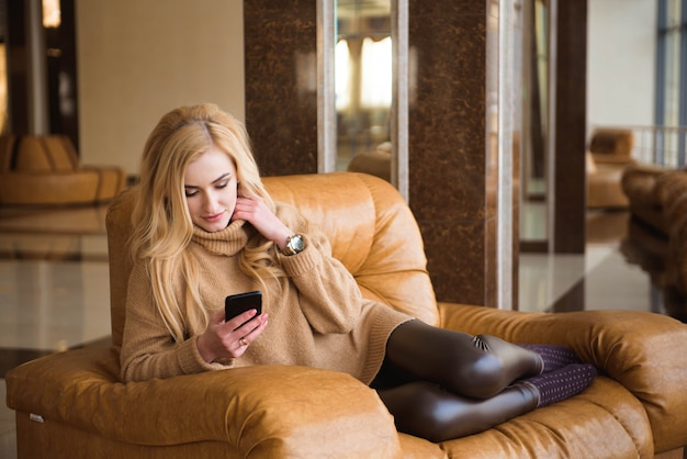 Attractive woman have a coffee break using her mobile phone