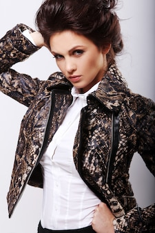 Attractive woman in leather jacket