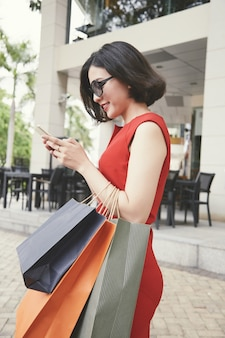 Attractive woman leaving shopping mall