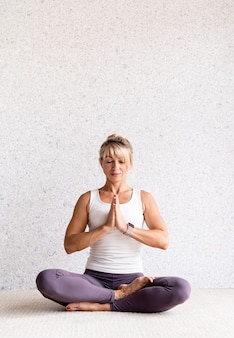 Attractive woman practicing yoga at home