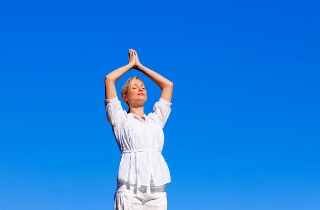 Attractive woman practising yoga