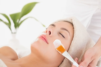 Attractive woman receiving treatment at spa center