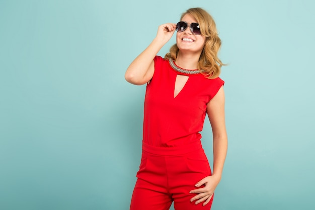 Attractive woman in red overalls and sunglasses