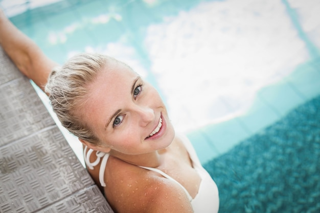 Attractive woman resting on the edge of the pool