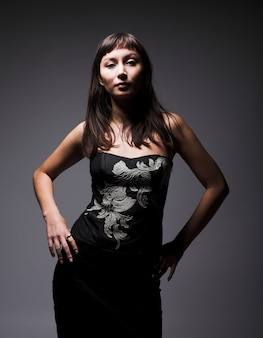 Attractive woman in sexy corset, dark style