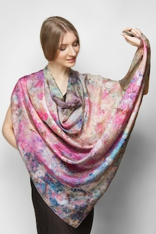 Attractive woman in slim dress and colorful silk scarf posing