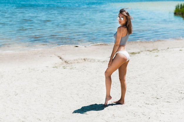 Attractive woman standing near water