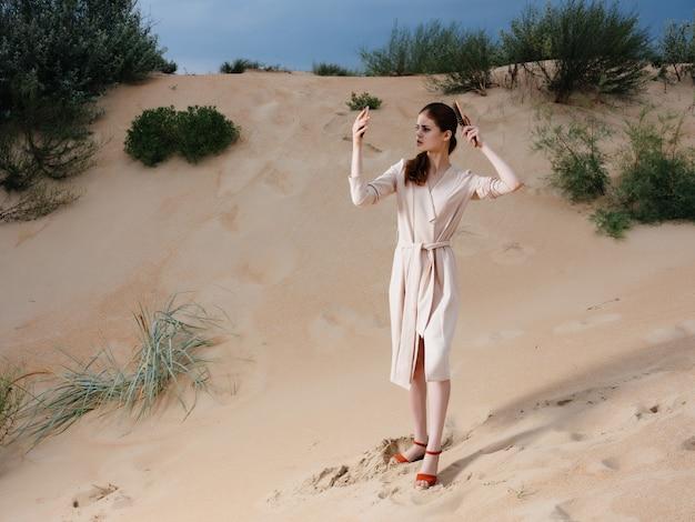 Attractive woman walk along the beach sand tropics model travel