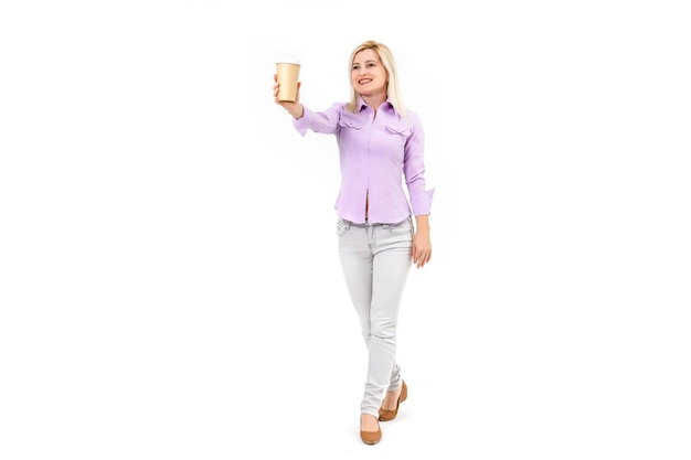 Attractive woman wearing shirt drinking takeaway coffee standing isolated over white background