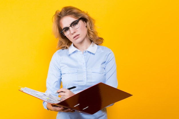 Attractive woman with big folder