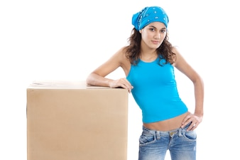 Attractive woman with box making a removal