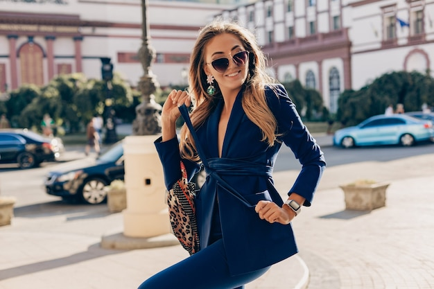 Attractive woman with long hair posing in city