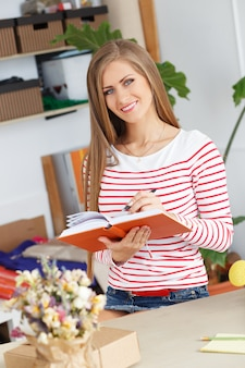 Attractive woman with notepad