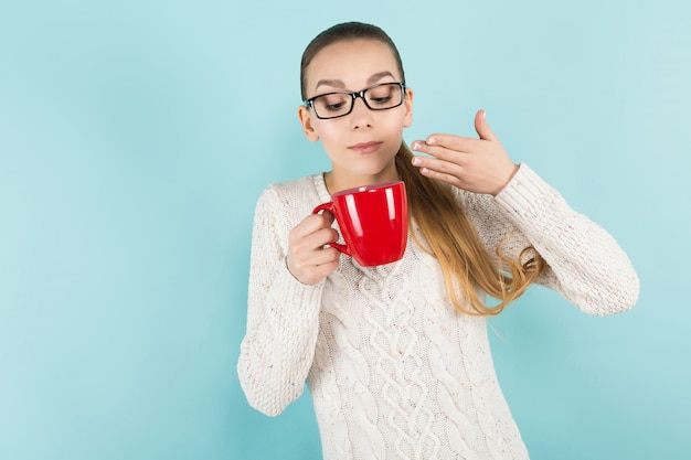 Attractive woman with ponytail and cup